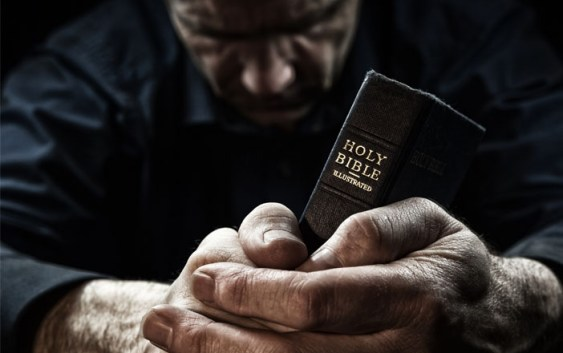 praying-christian-man-with-holy-bible